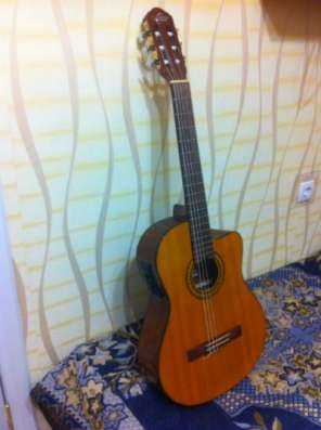 Электро-акустическую гитару + с бонусом