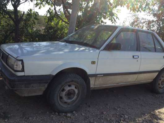 Продается автомобиль Ниссан-Санни седан белый